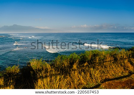 Surfing at sunrise on Hookipa State Park Beach, Maui, Hawaii, USA - stock photo