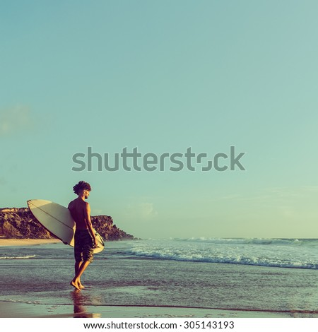 Surfing. Freedom. Paradise. Life. Surfer on the Beach - stock photo