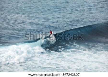 surfing on big waves view from air above - stock photo