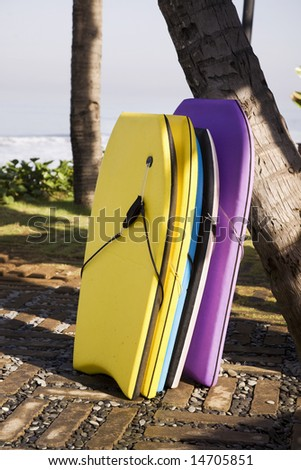 surfing with colored boards - stock photo