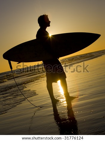 Surfs up at Sunset - stock photo