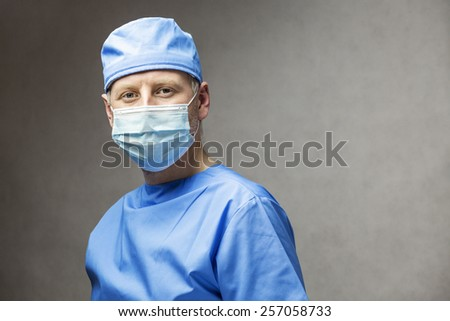 Surgeon doctor in medical clothes - stock photo