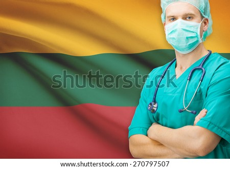 Surgeon with national flag on background - Lithuania - stock photo
