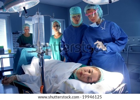 surgeons in operative room - stock photo