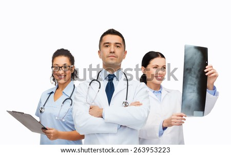 surgery, profession, people and medicine concept - group of medics with x-ray - stock photo