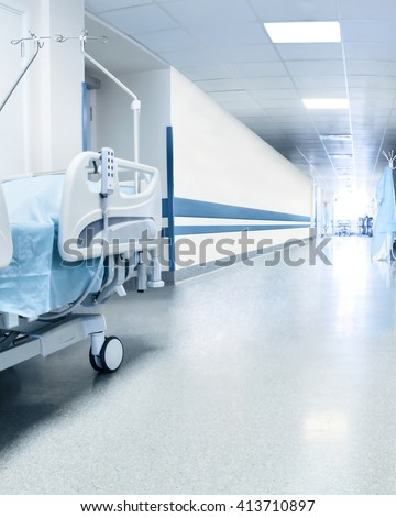 Surgical bed in hospital's corridor near operation room. Tinted picture - stock photo