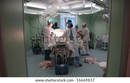 surgical operation, at the doors of the operating-room - stock photo