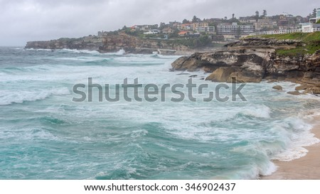 Surging waves from the Tasman Sea break upon Bronte Beach, New South Wales, Australia. - stock photo