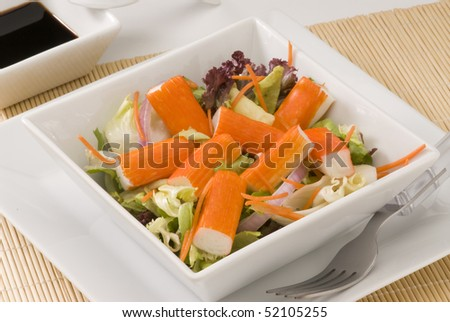 Surimi salad in a white square plate. Selective focus. - stock photo