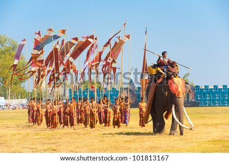 SURIN, THAILAND - NOVEMBER 20, 2010: A Burmese general marches in with his soldiers during the Burmese Siamese War reenactment at the Surin Elephant Roundup on November 20, 2010 in Surin, Thailand - stock photo
