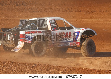 SURPRISE, AZ - APR 16: Carl Renezeder (17) at speed in Pro 2 Unlimited Lucas Oil Off Road Series racing on April 16, 2011 at Speedworld Off Road Park in Surprise, AZ. - stock photo