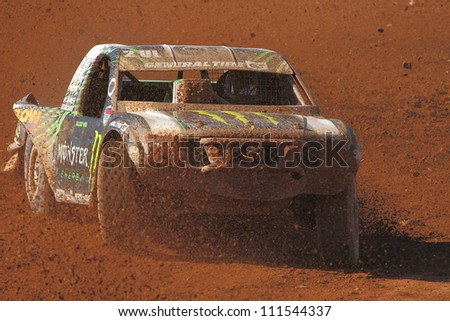 SURPRISE, AZ - APR 16: Casey Currie (2) at speed in Lucas Oil Off Road Series Pro Lite Unlimited racing on April 16, 2011 at Speedworld Off Road Park in Surprise, AZ. - stock photo