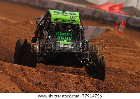 SURPRISE, AZ - APR 16: Curt Geer (385) at speed in round 3 action of Lucas Oil Off Road Series Limited Buggy racing on April 16, 2011 at Speedworld Off Road Park in Surprise, AZ. - stock photo