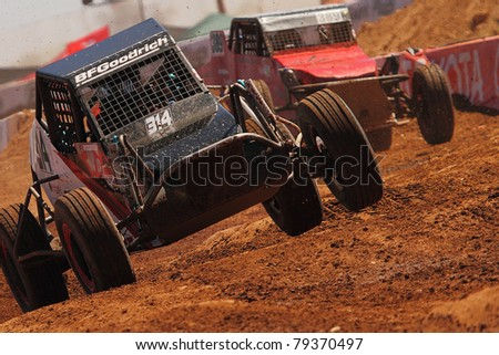 SURPRISE, AZ - APR 16: John Fitzgerald (314) at speed in round 3 action of Lucas Oil Off Road Series Limited Buggy racing on April 16, 2011 at Speedworld Off Road Park in Surprise, AZ. - stock photo