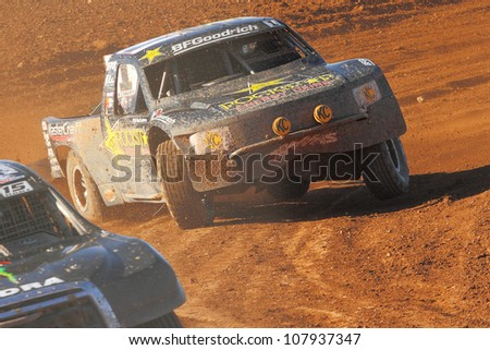 SURPRISE, AZ - APR 16: Rob McCahren (1) at speed in Pro 2 Unlimited Lucas Oil Off Road Series racing on April 16, 2011 at Speedworld Off Road Park in Surprise, AZ. - stock photo