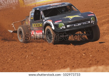 SURPRISE, AZ - MAY 18: Brian Deegan (38) at speed in Lucas Oil Off Road Series racing Pro 2 Unlimited practice on May 18, 2012 at Speedworld Off Road Park in Surprise, AZ. - stock photo