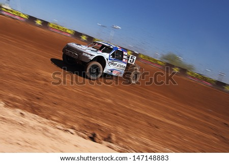SURPRISE, AZ - SEP 23: Travis Coyne (5) at speed in Pro 4 Unlimited Lucas Oil Off Road Series practice on Sept. 23, 2011 at Speedworld Off Road Park in Surprise, AZ. - stock photo