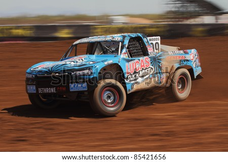 SURPRISE, AZ - SEPT 24: Robby Woods (99) at speed in Pro 2 qualifying for Lucas Oil Off Road Series racing on Sept. 24, 2011 at Speedworld Off Road Park in Surprise, AZ. - stock photo