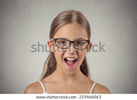 Surprise. Closeup portrait teenager girl with glasses shocked wide open mouth eyes jaw drop blown away isolated grey wall background. Human emotion facial expression feeling body language reaction - stock photo