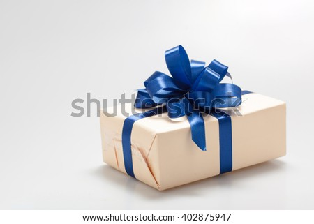 surprise gift box with blue ribbon on white background with copy space - stock photo