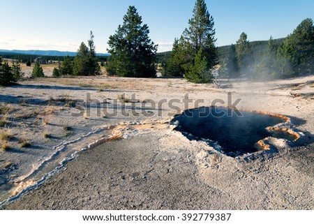 Surprise Pool is a hot spring pool in the Lower Geyser Basin of Yellowstone National Park in the United States - stock photo