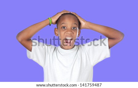 Surprised african adolescent on a blue background - stock photo