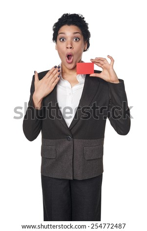 Surprised african american business woman showing blank credit card, over white background. Excited businesswoman with opened mouth. - stock photo