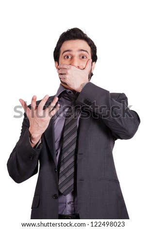 surprised and shocked businessman covering his mouth with his hands - stock photo