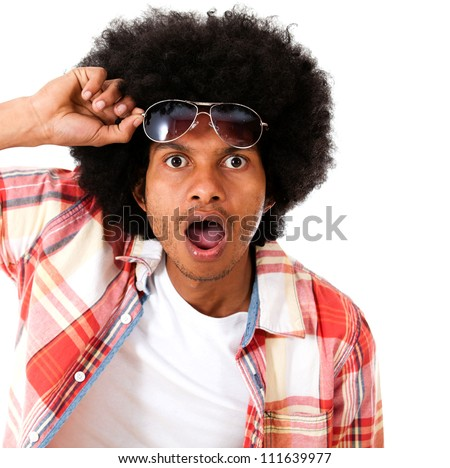 Surprised black man taking a good look - isolated over a white background - stock photo
