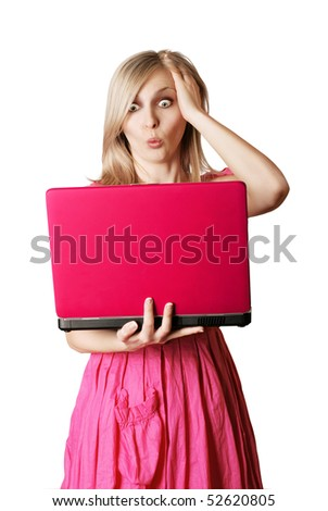 surprised blonde in pink dress with laptop isolated on white - stock photo