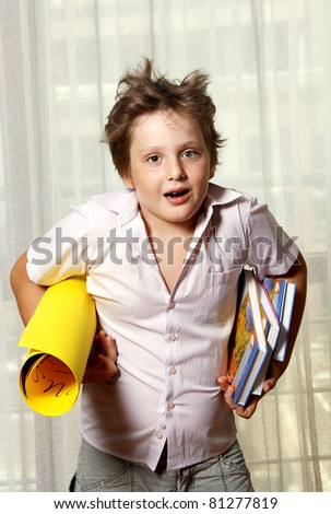 surprised boy with books - stock photo