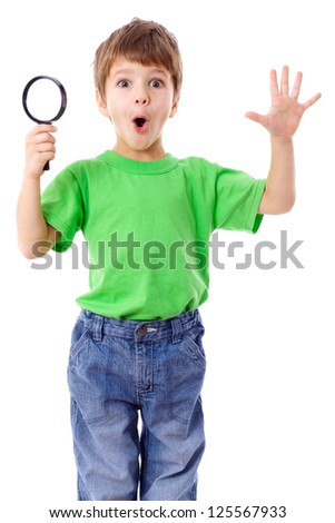 Surprised boy with magnifying glass, isolated on white - stock photo