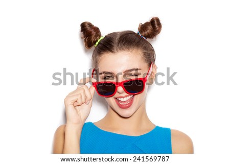 Surprised Brunette Woman in sunglasses. Beauty girl with bright makeup hairstyle with horns in a blue dress having fun. On a white background, not isolated - stock photo