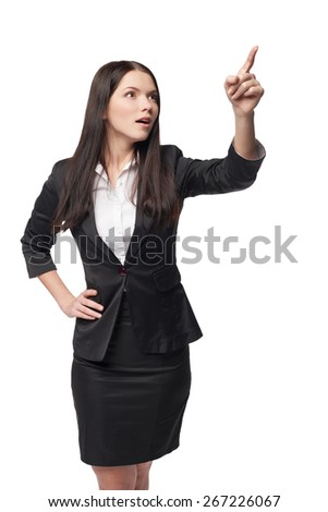 Surprised business woman pointing at blank copy space, isolated over white - stock photo