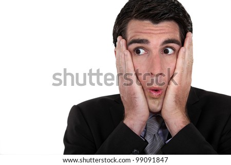 Surprised businessman - stock photo