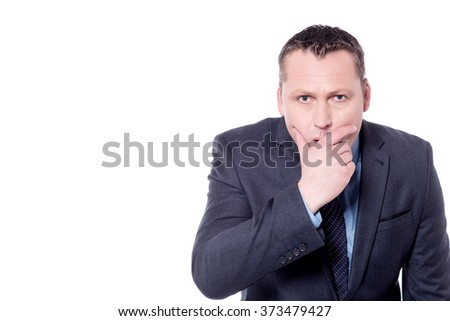 Surprised businessman covering his mouth with hand - stock photo