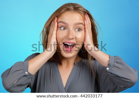 Surprised businesswoman  amazed or shocked by unexpected news - stock photo