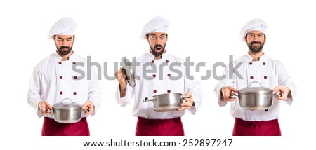 Surprised chefs holding pots - stock photo