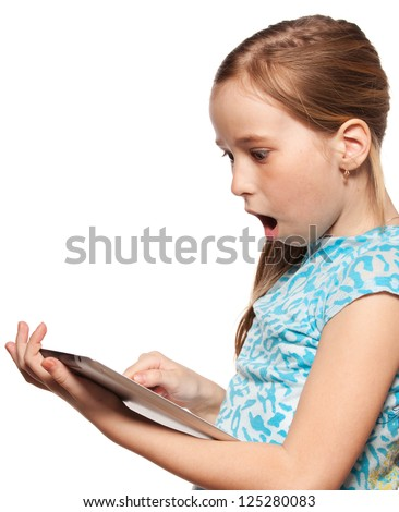 Surprised child looks to the tablet computer. Kid with tablet isolated on white background - stock photo