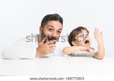 Surprised dad and son - stock photo