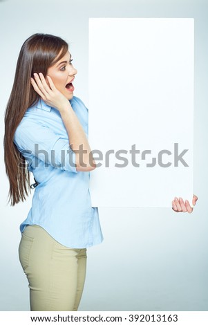 Surprised emotional business woman hold big sign board. Isolated studio portrait. - stock photo