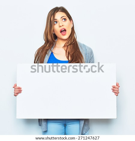 Surprised emotional woman holding signboard. Female model hold white blank business card. - stock photo