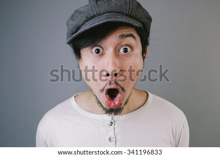 Surprised face of Asian man. - stock photo