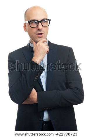 surprised fashionable bald man wearing glasses looking away. Isolated - stock photo