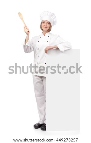 surprised female chef, cook or baker holding spoon pointing up and standing next to the banner with empty copy space for text isolated on white background. advertisement blank board. your text here - stock photo