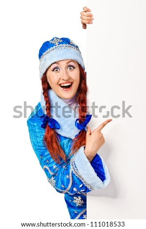 Surprised girl dressing in traditional russian christmas costume  (Snow Maiden) with blank banner, isolated on white background - stock photo