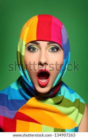 Surprised girl in a colorful scarf - stock photo