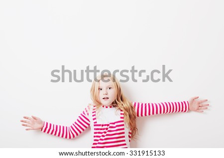 surprised girl on background wall - stock photo