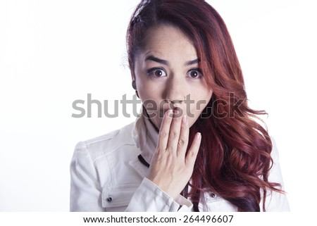Surprised girl on white background - stock photo