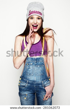 Surprised girl portrait. Studio shot of pretty model on grey background - stock photo
